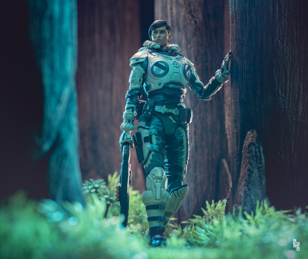 A Kait Diaz figure cautiously walking through a forest setting, holding a gnasher in her right hand
